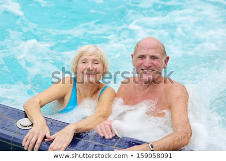 Couple having fun in jacuzzi Stock photo © nyul
