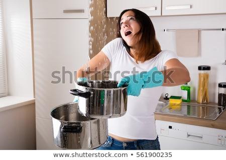 Donna chiamando idraulico raccolta acqua sink Foto d'archivio © AndreyPopov