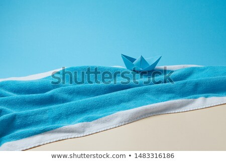 Seashore made from colored terry towels on doutone paper background. Stock photo © artjazz