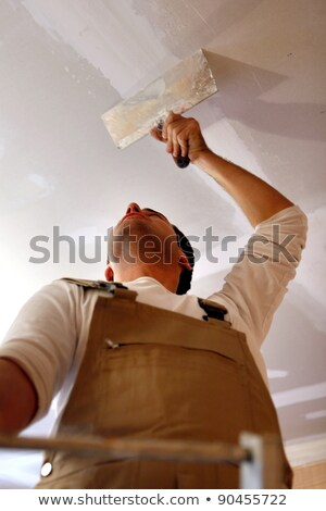 plasterer putting plaster on a ceiling stock photo © kzenon