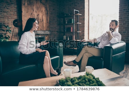Male Psychologist Discussing Questions With Her Patient In Room Stock photo © AndreyPopov