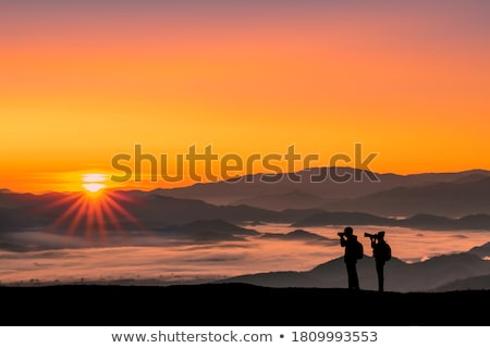 Hikers Couple with Backpacks and Photo Camera Stock photo © robuart