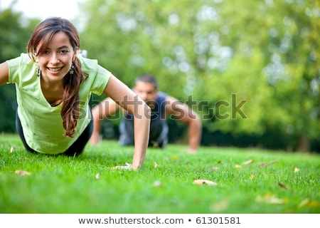 man push up exercise workout fitness doing outside on grass in stock photo © freedomz