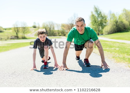 Family, mother and son are running or jogging for sport outdoors Stock photo © Lopolo