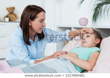 Młodych brunetka kobieta patrząc chorych córka Zdjęcia stock © pressmaster