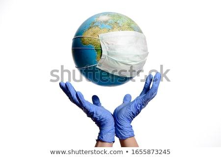 Stock photo: Globe With A Mask And Text Coronavirus
