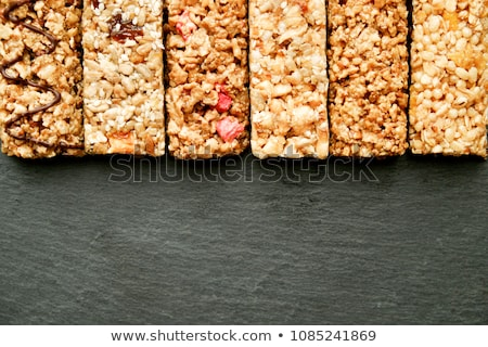 Row of mixed gluten free granola cereal energy bars. With dried fruits and nuts. Stock photo © dash