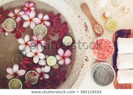 Spa petali ciotola tropicali fiori pedicure Foto d'archivio © galitskaya
