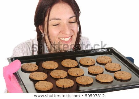 beautiful housewife with completed cakes Stock photo © vladacanon