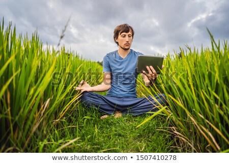 красивый мужчина йога Смотреть образовательный видео таблетка Сток-фото © galitskaya