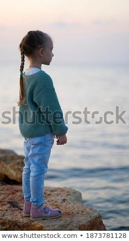 Cute bambina piedi vicino spiaggia tramonto Foto d'archivio © Lopolo