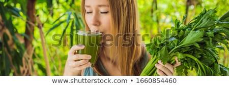 Mulher jovem bebidas aipo suco saudável beber Foto stock © galitskaya