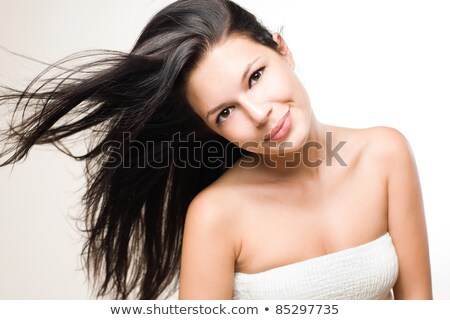 Joyful relaxed brunette with flowing hair. Stock photo © lithian