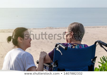 Father walking disabled son at the beach Stock photo © jarenwicklund