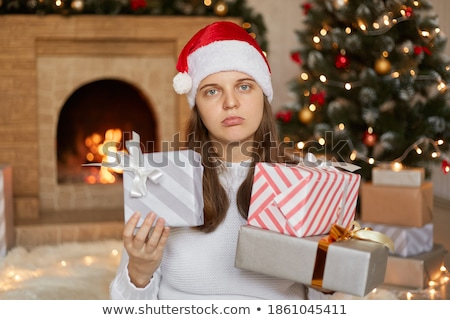 beautiful woman looking at the present near her face Stock photo © Rob_Stark