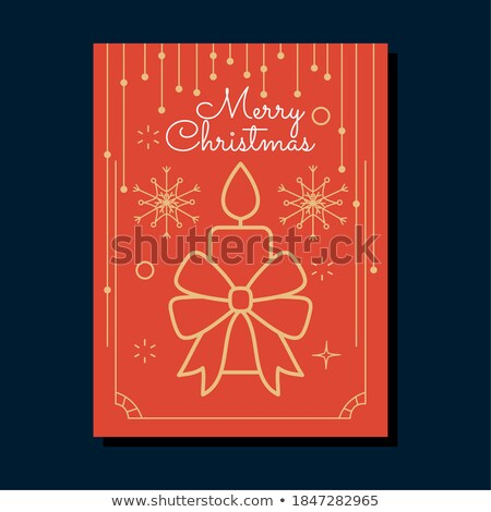 christmas decorations and candles over blue background stock photo © andreykr