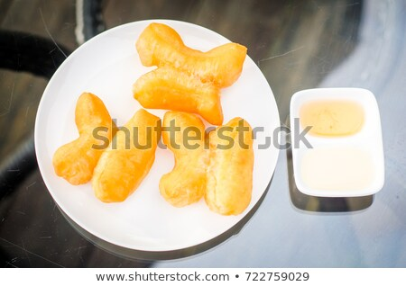Deep-fried Dough Sticks Custard condensed milk and orange juice Stock photo © nuttakit