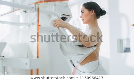 Stock photo: Female controlling breast for cancer