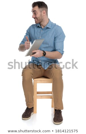 Hands Up! Good Looking Smart Man With Tablet Computer stock photo © adamr