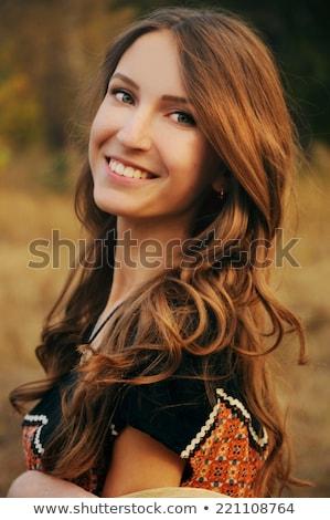 mosolygó · nő · haj · közvetlenül · kamera · piros · nő - stock fotó © stryjek