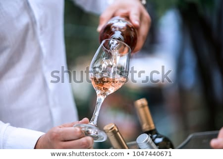 Couple potable rose vin restaurant sourire Photo stock © photography33
