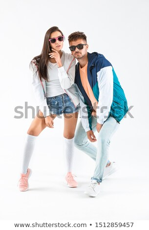young couple wearing sunglasses and trendy clothing stock photo © photography33