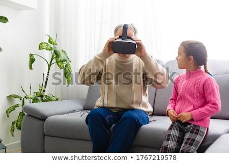 Férfi visel szemüveg kar nyújtott kéz Stock fotó © photography33