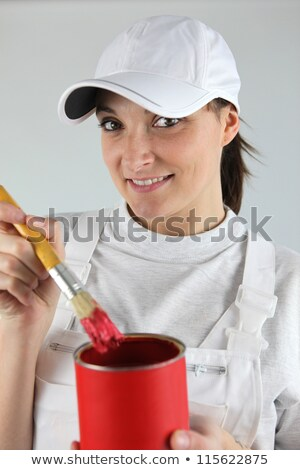 Female decorator has chosen red paint Stock photo © photography33