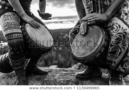 Young man with a djembe drum Stock photo © photography33