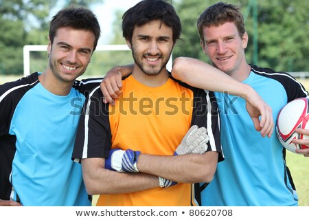 Three young footballers in front of goal Stock photo © photography33