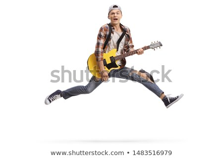 Boy playing an electric guitar isolated Stock photo © RTimages