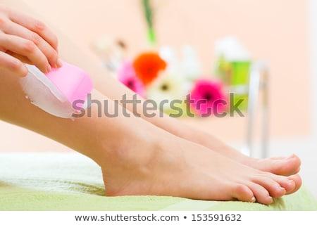 nő · krém · szexi · meztelen · lábak · szedőlapát - stock fotó © stryjek