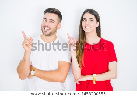 Attractive young casual man welcoming with hands together and big smile over white background Stock photo © feedough