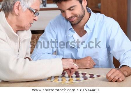 молодым человеком игры старушку семьи человека Сток-фото © photography33