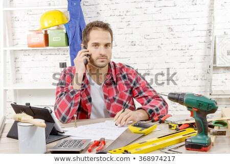 Artisan sitting on desk Stock photo © photography33