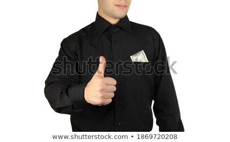 Businessman with money in pocket showing okay sign Stock photo © shutswis