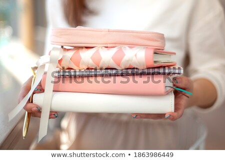 Woman carrying a personal organizer Stock photo © photography33