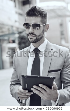 Stock photo: Goodlooking men with tablet computer on urban street