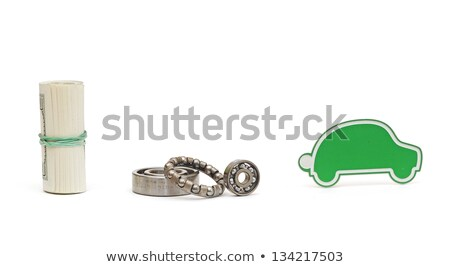 bearing, small car and dollar bills isolated on white Stock photo © inxti