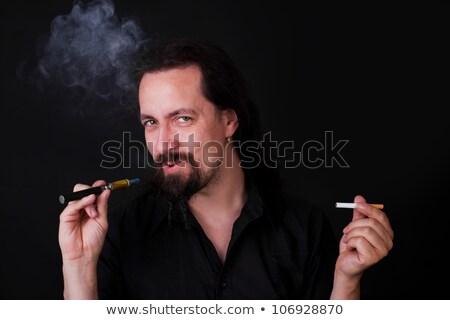 Handsome caucasion man smoking e-cigarette Stock photo © Pasiphae