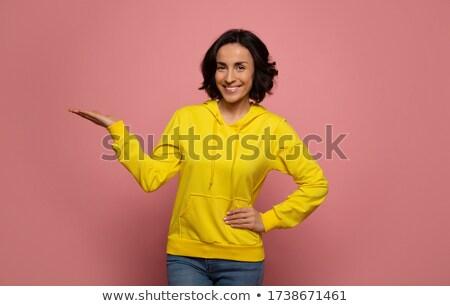 şık genç kadın avuç içi portre gri elbise Stok fotoğraf © pablocalvog