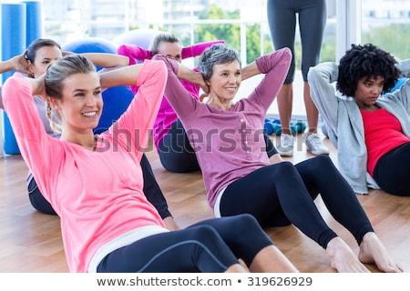Młoda kobieta wykonywania drewnianej podłogi biały ciało fitness Zdjęcia stock © wavebreak_media