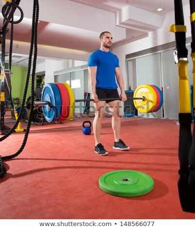 Crossfit fitnessz tornaterem súlyemelés bár felszerlés Stock fotó © lunamarina