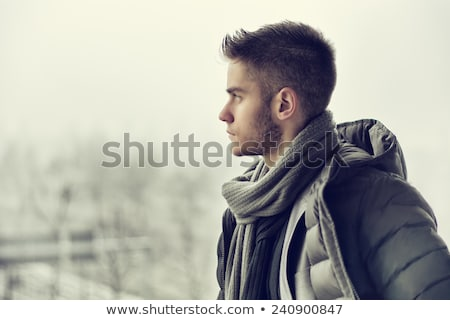young male model wearing winter jacket stock photo © get4net