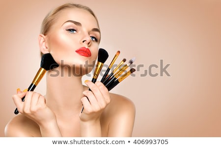 blonde woman holding set of brushes stock photo © chesterf