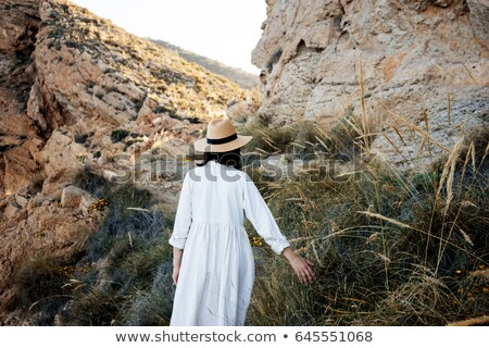Long-haired brunette in a straw hat Stock photo © maros_b