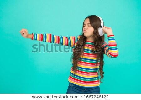 Enyém portré gyönyörű fiatal nő zenét hallgat Stock fotó © lithian