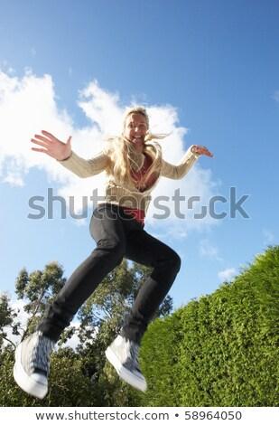 Mulher jovem saltando trampolim ar mulher saltar Foto stock © monkey_business