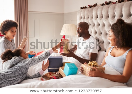 Young mixed race family on Christmas morning Stock photo © monkey_business