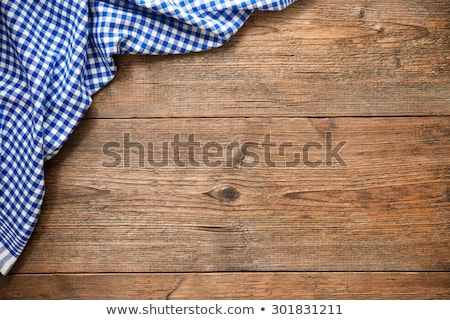 Wooden background with a blue checkered tablecloth and wooden spoon Stock photo © Zerbor